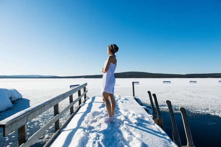 Enjoying wintry water in Finland.