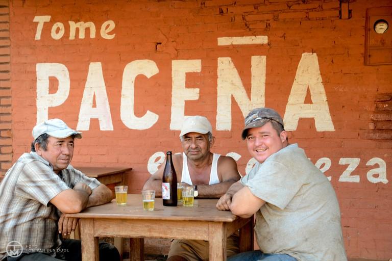 Bolivians drinking Beer