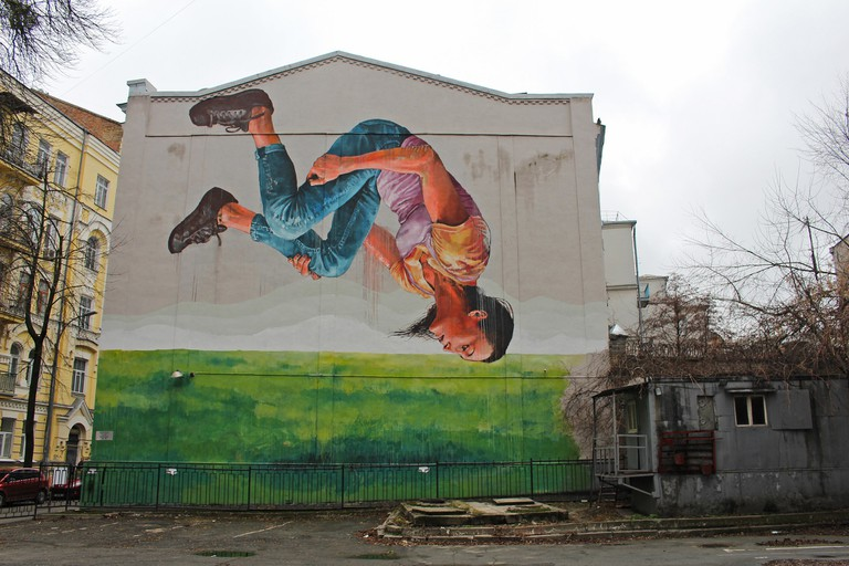 Somersaulting Woman mural in central Kiev