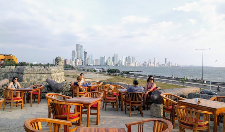 At sunset, tourists flock to Cafe del Mar along Cartagena's wall