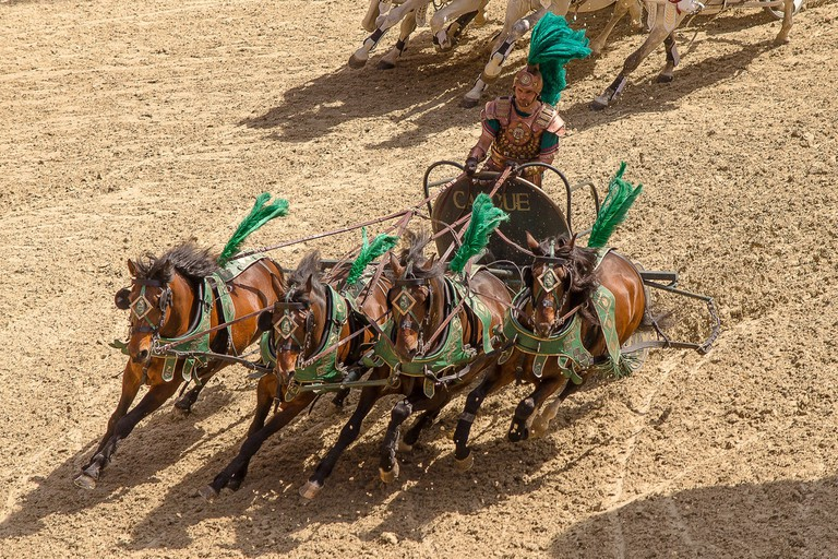 A charioteer in a four-horse chariot
