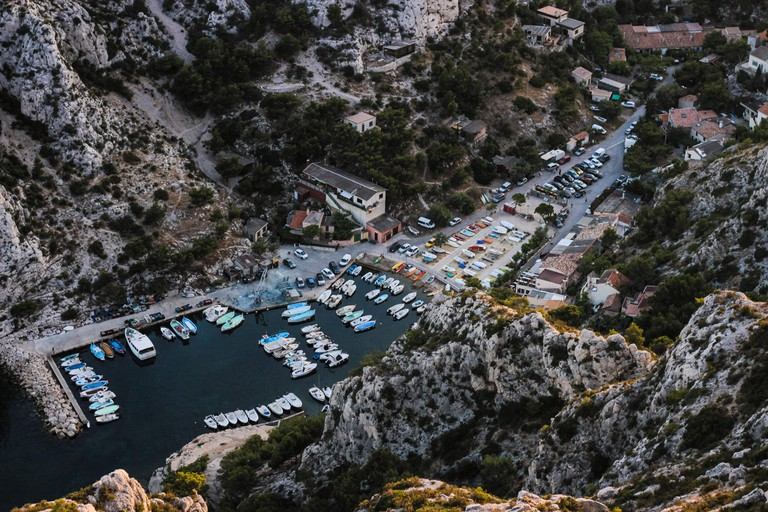 Frydman sold trips to the south of France, like the Calanques near Marseille |© Adam Dore / Unsplash