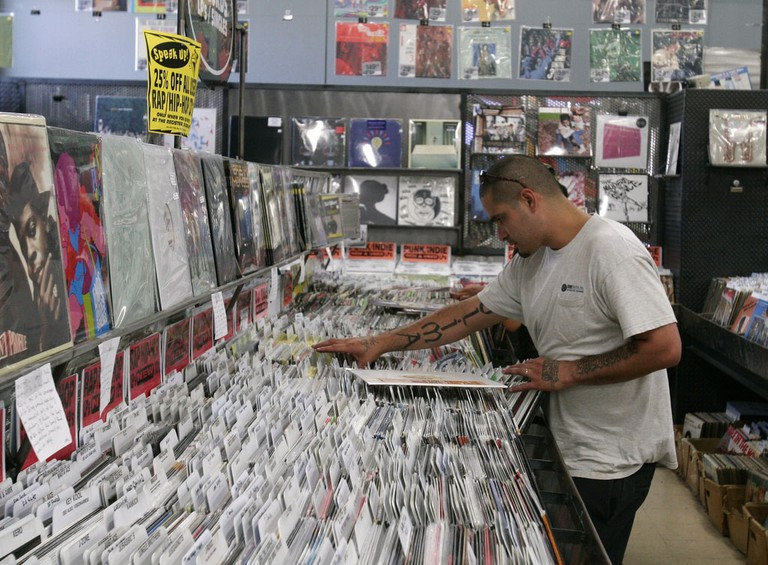 A vinyl enthusiast perusing a selection of records