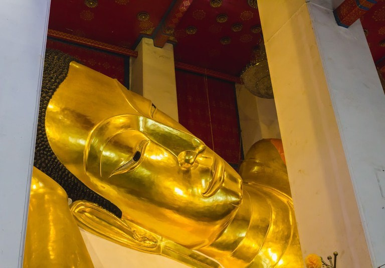 Head of the long reclining Buddha statue at Singburi's Wat Phra Non Jaksi
