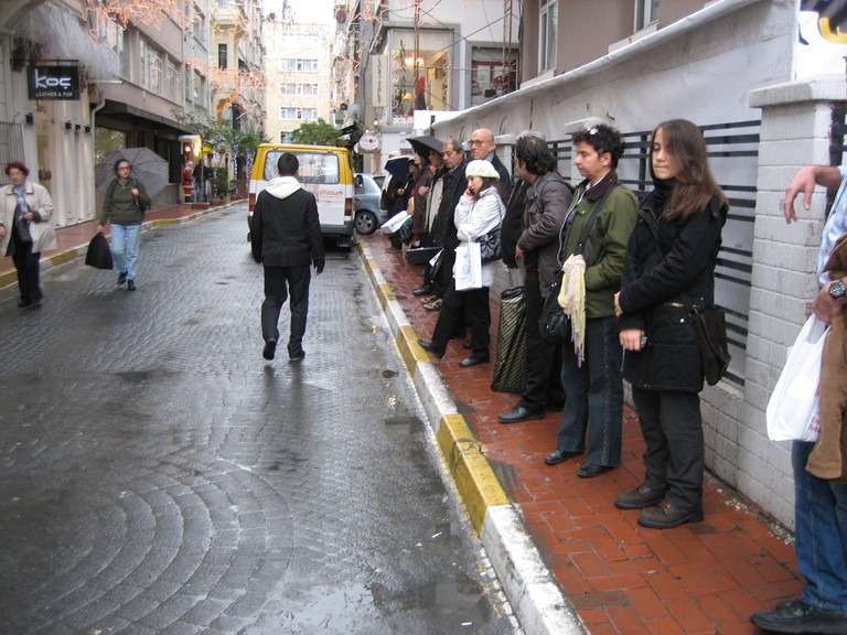 A group of travellers waiting for a dolmuş