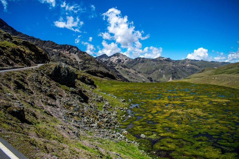 The Lares trail is marked by bright mossy lakes and volcanic rocks