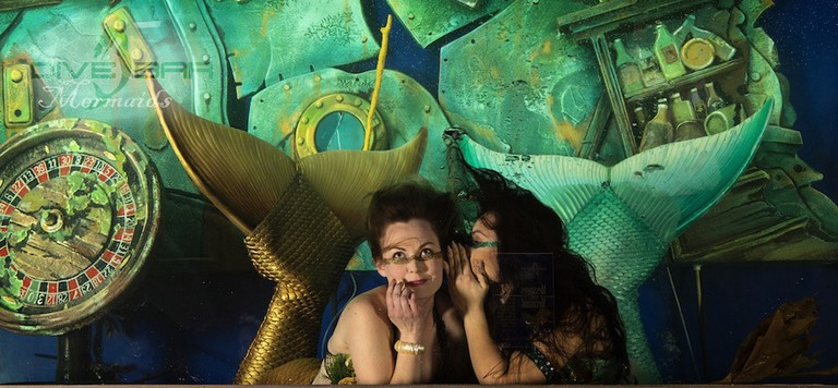 Mermaids hang out in their tank