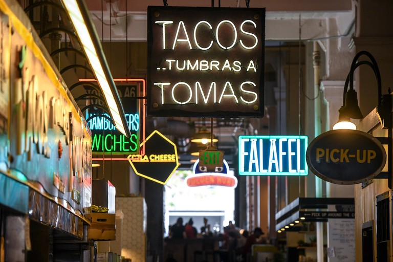 The market's neon signs