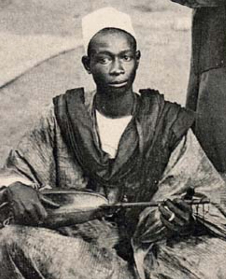An old photo of a traditional Griot