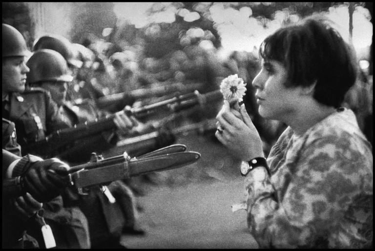 USA. Washington DC. 1967. An American young girl, Jan Rose Kasmir, confronts the American National Guard outside the Pentagon during the 1967 anti-Vietnam march.