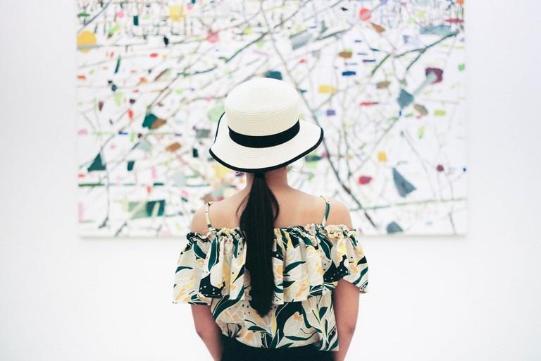 A woman looking at art