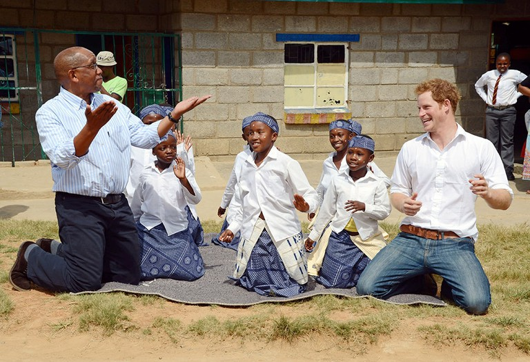 Prince Harry and Prince Seeiso dancing during a visit to the Kananelo Centre for the Deaf in Maseru