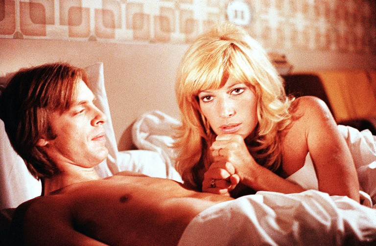 Keith Carradine and Monica Vitti in' An Almost Perfect Affair'