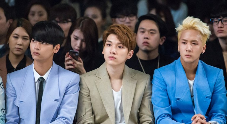 Members of K-pop band VIXX flaunt flawless skin at a fashion event