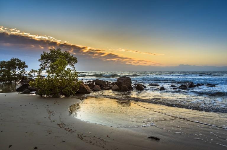 Port Douglas cloudy morning coral sea ocean waves rocky shore, Australia