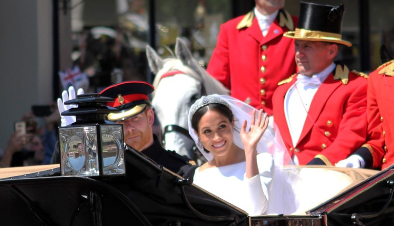 rince Harry and Meghan Markle wedding carriage procession through streets of Windsor then back the Windsor Castle waving to crowd, UK