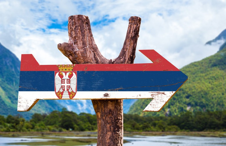 Serbia Flag wooden sign with mountains background