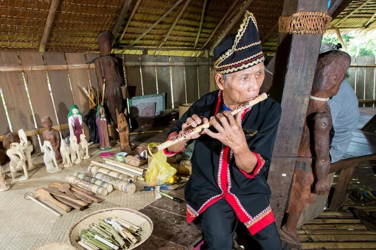 Bidayuh tribe playing flute
