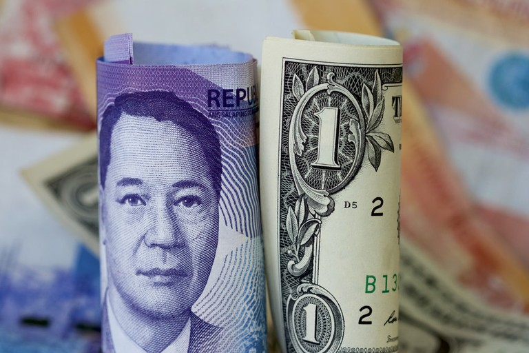 The Philippines peso and a US dollar note