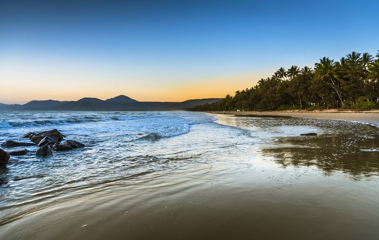 Dawn sky Port Douglas tropical 4 mile beach Coral Sea, Australia