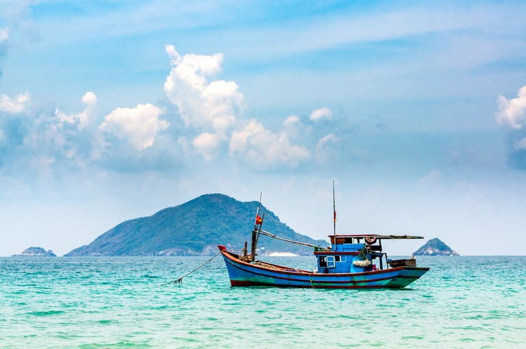 Boats and tropical beach, Con Dao island, Con Son bay, Vietnam
