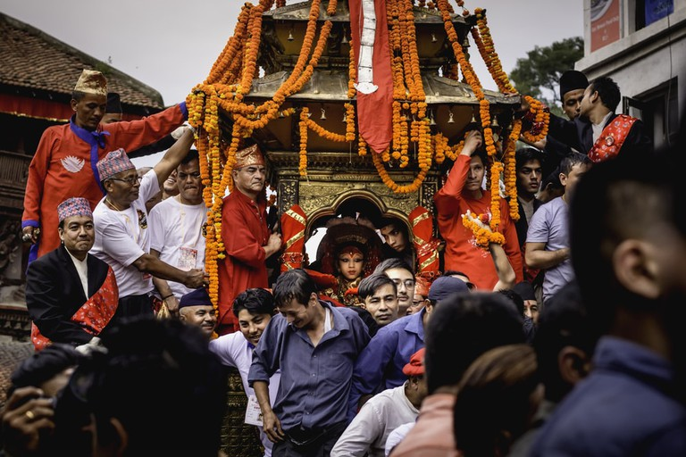 Chariot of living goddess Kumari pulled by the local passing through Basantapur, Kathmandu, Nepal