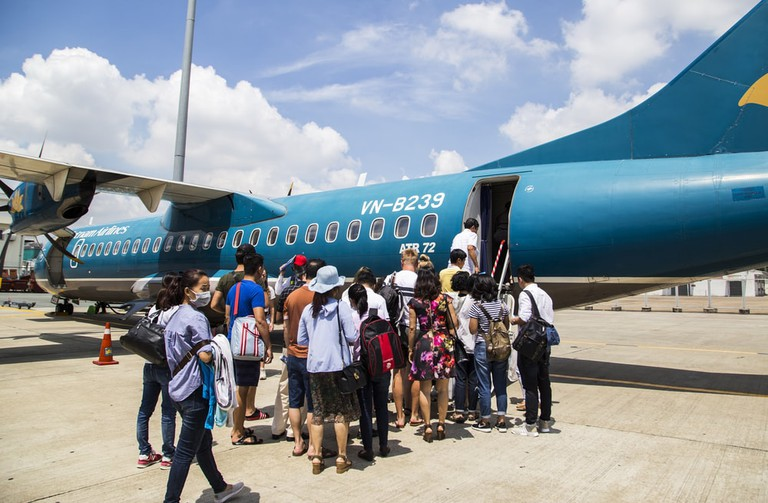 Passengers are boarding the aircraft of Vietnam Airline to Con Dao at Tan Son Nhat international airport in Saigon, Vietnam