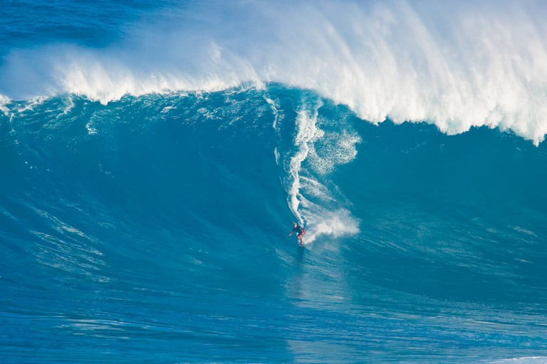 "Professional surfer Laird Hamilton rides a giant wave at the legendary big wave surf break known as ""Jaws"" during one the largest swells of the winter March 13, 2011 in Maui"