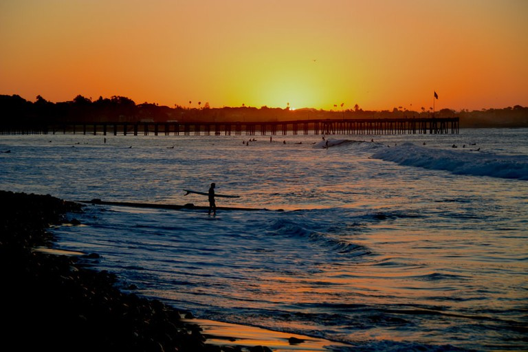 Dedicated surfers rise with the sun