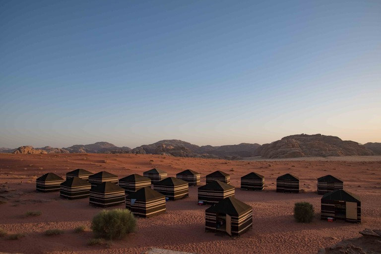 Typical Bedouin tent camp at sunset in Wadi Rum