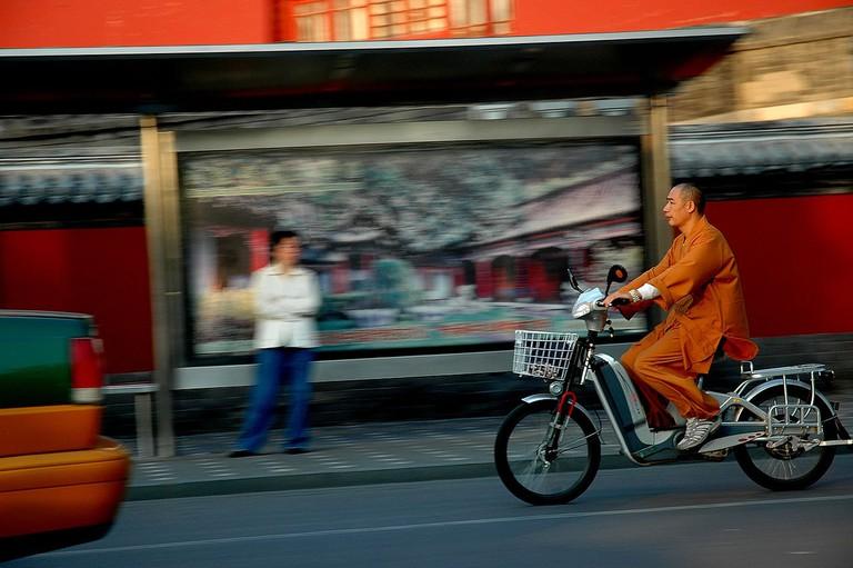 1280px-Chinese_Buddhist_Monk_Electric_Bike