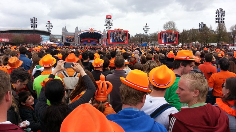 People celebrating King's Day on Amsterdam's Museumplein