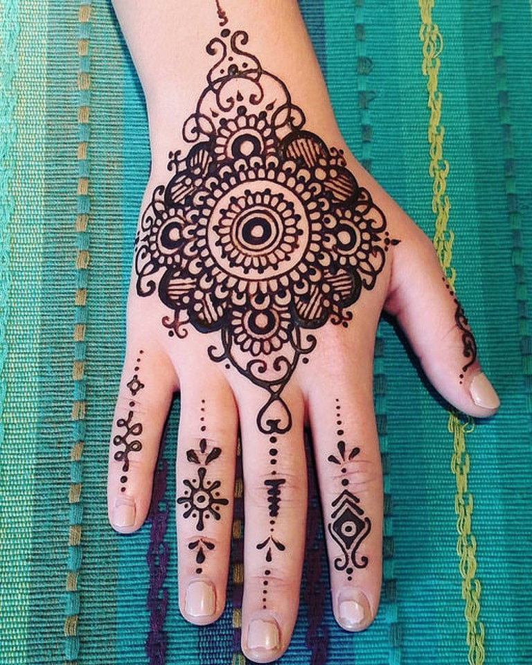 Getting intricate henna designs on your hands is a famous Eid tradition