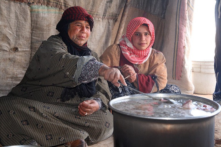 Bedouin cooking in a tent