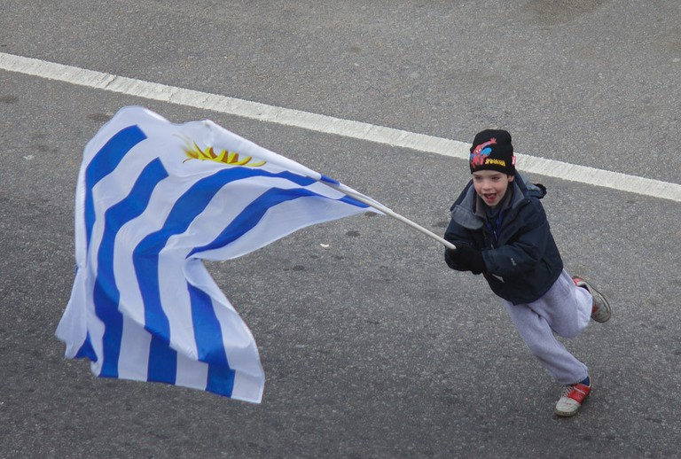 Uruguay's flag, kid with flag