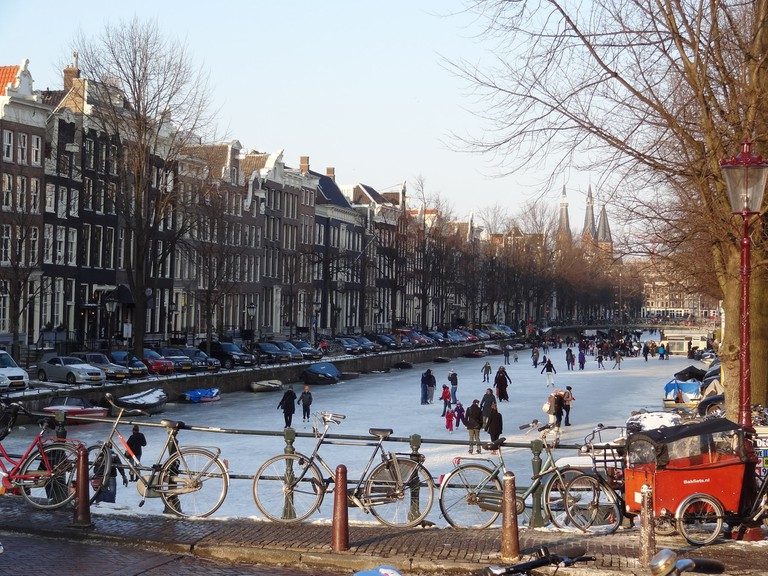 People ice-skating on Amsterdam's frozen canals