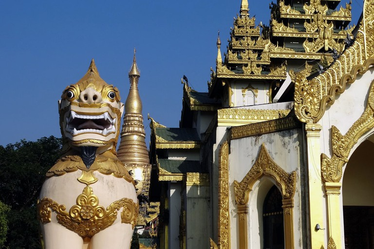 A-Chinthe-Stands-Guard-Outside-a-Shwedagon-Entrance