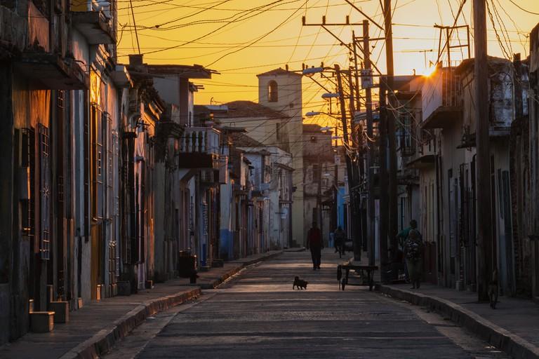Sunrise over Camaguey city street, Camaguey, Cuba
