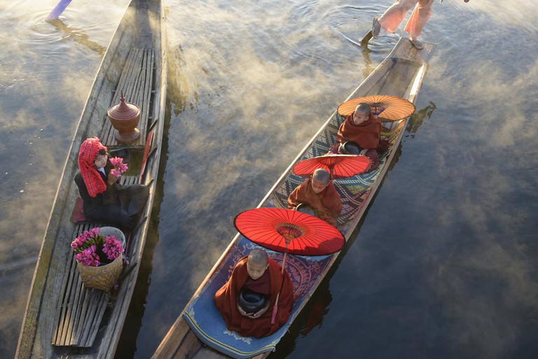 Gondoliers rowing canoes in Asia