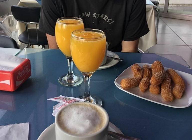 Orange juice, coffee, and churros