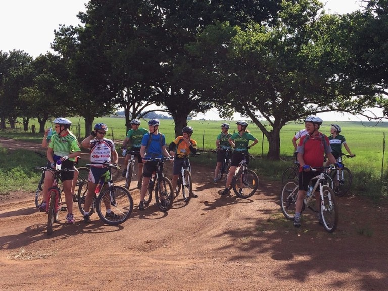 A group of cyclists enjoying Chrissiesmeer's pastoral scenes
