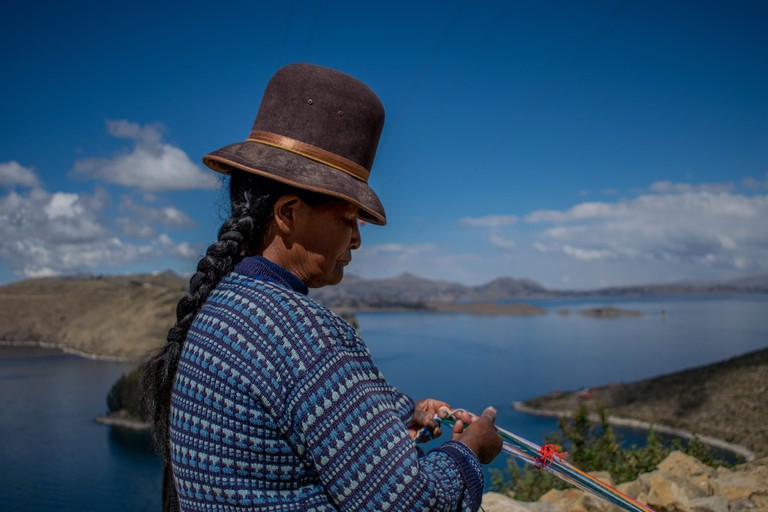 AnAymará woman weaving on Bolivia's Isla del Sol