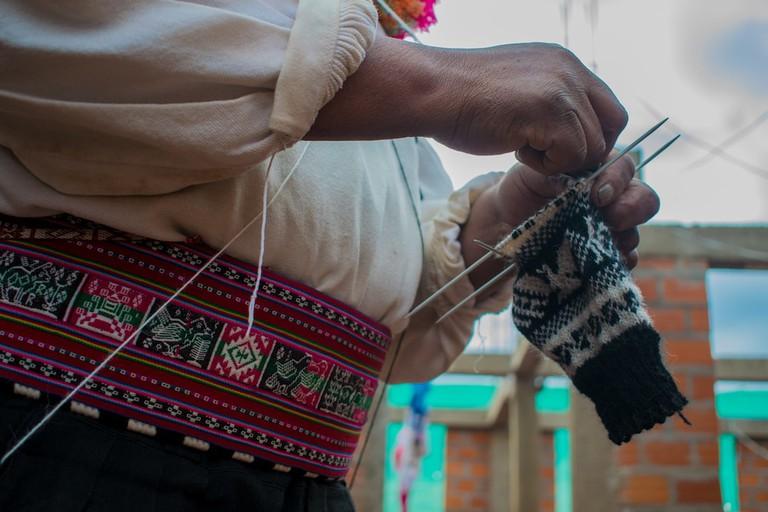 A Taquileño man wearing a calendarchupi (waistband) woven by the local women