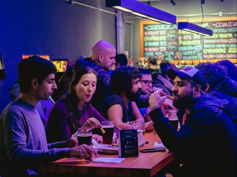 With a wide variety of craft beers, finger food, and boutique video games, this bar in Buenos Aires gets the best of each world