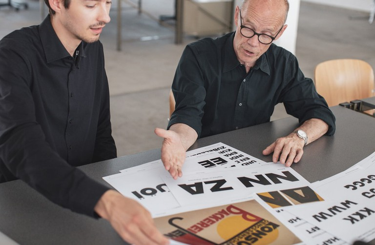 Spiekermann and a student discuss archival images of Bauhaus fonts
