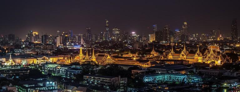Bangkok's Grand Palance glows against the city skyline