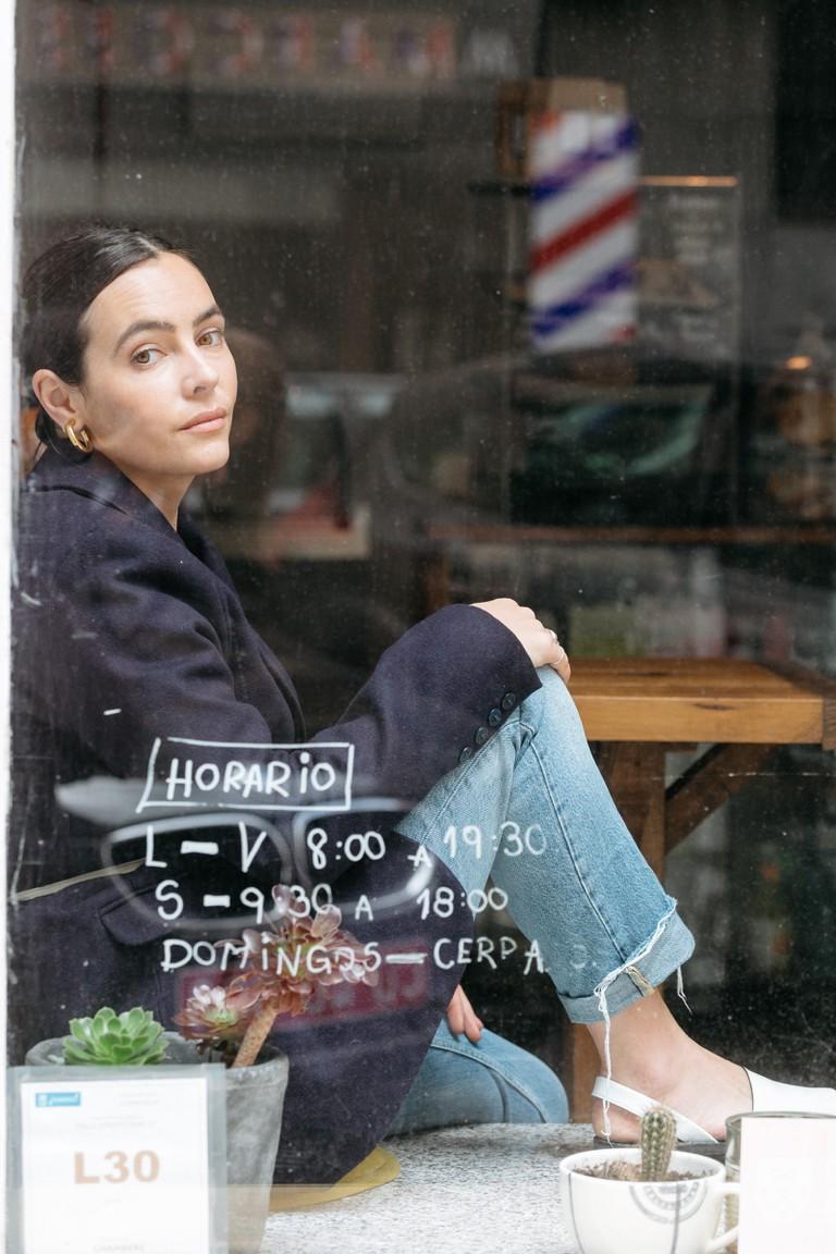 GOYA founder and designer Kimberley Tecles-Byrom in Santa Kafeina coffee shop
