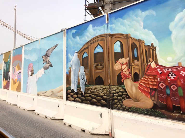 Murals adorn the expressway in Doha