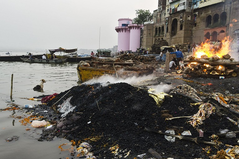 The banks of the River Ganges in Varanasi, where thousands are cremated every year, leading to heavy pollution and ecological damage