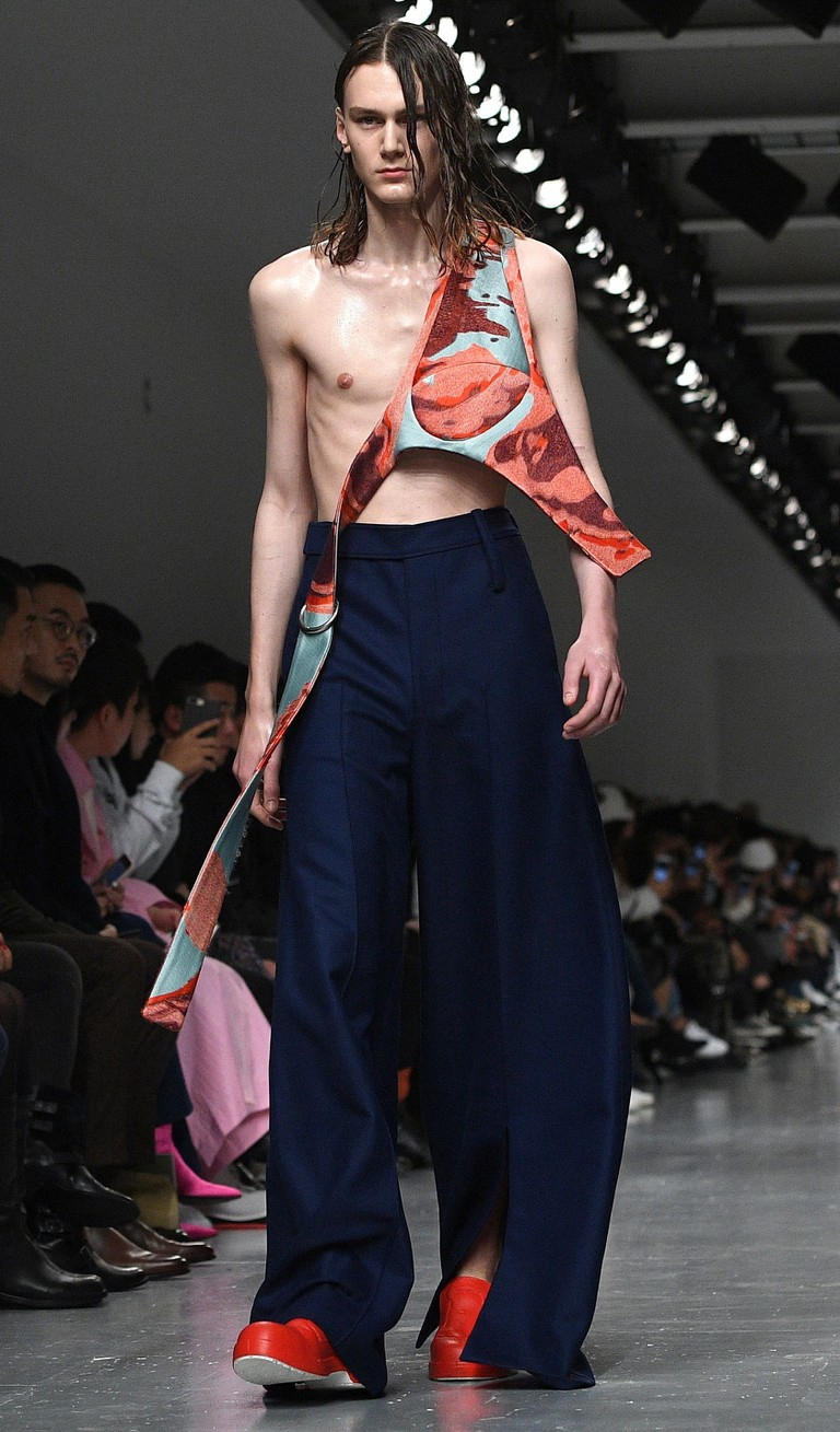 A model presents a creation by Ximon Lee during the London Men's Fashion Week